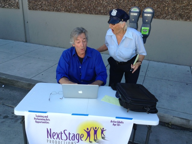 "Meter maid Carole English is the incoming President of the Board of NextStage Productions. Pictured here with Comic Richard Stockton, she is recruiting him to be MC of the Nextstage ""LOVE IN"" scheduled for August 26th 3-6pm at Louden Nelson Community Center."