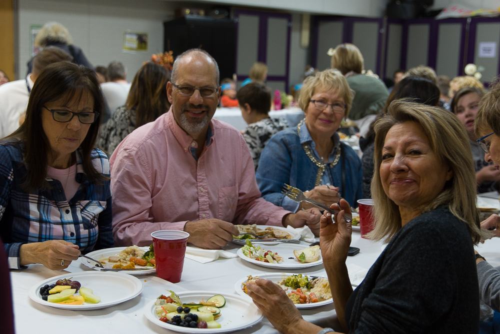 Mr. Stoecker and LCS office staff share a meal together at the LCS family Thanksgiving feast.