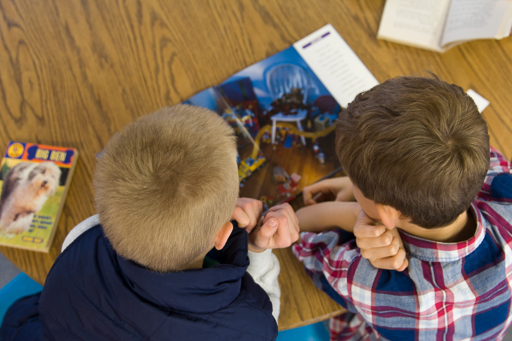 Elementary students read together in the LCS library.
