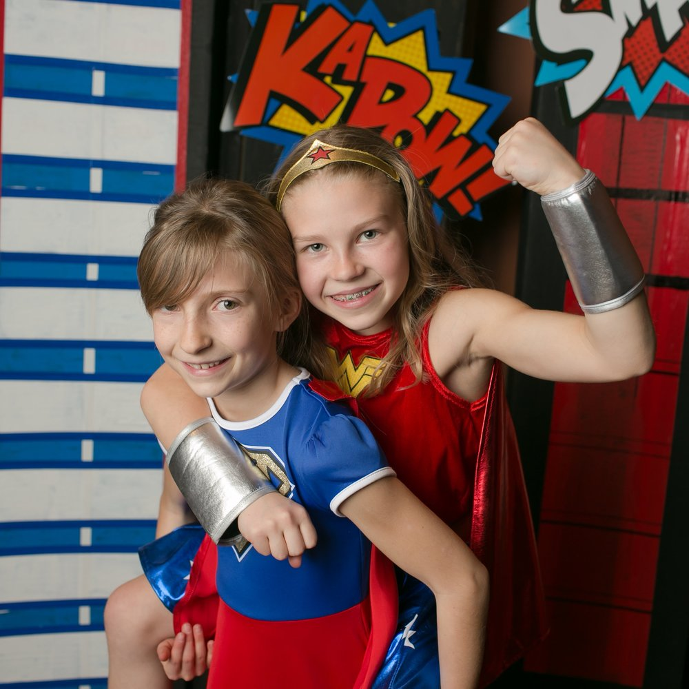 "Two students pose at the ""Marvel""ous Community Night."