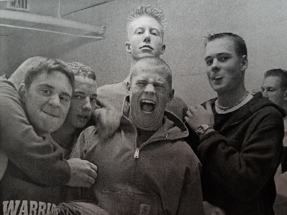 The Warriors basketball varsity team celebrates a win, ca. 2000