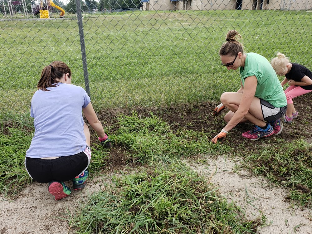 PTO members help at the Community Day clean-up.