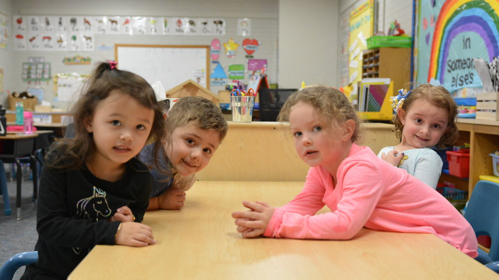 PreK3 students celebrate a birthday in Ms. Prado's class.  At LCS, students form life-long friendships in addition to academic and social skills.