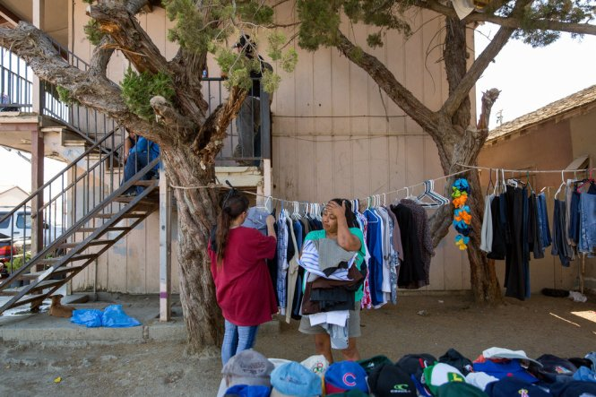 Maria Salazar, right, shopped at a yard sale held by Selena Rodriguez, left, at an apartment complex in Huron, Calif., near farmland that is part of the Westlands Water District. CreditDamon Winter/The New York Times