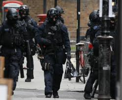 Specialist tactical officers moving through Victoria Village