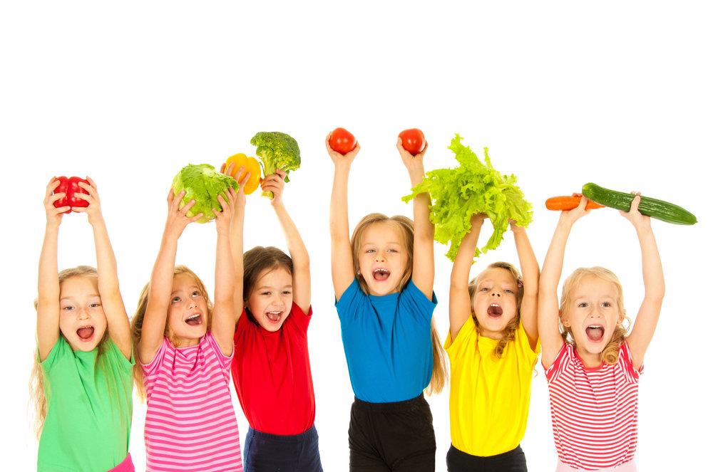 kids with veggies.jpeg