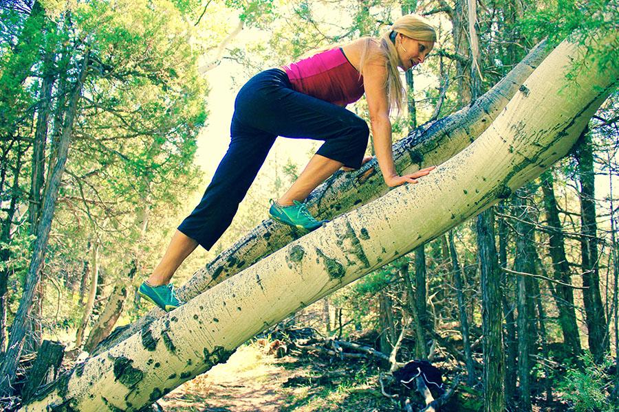 Woman climbing up tree.jpg