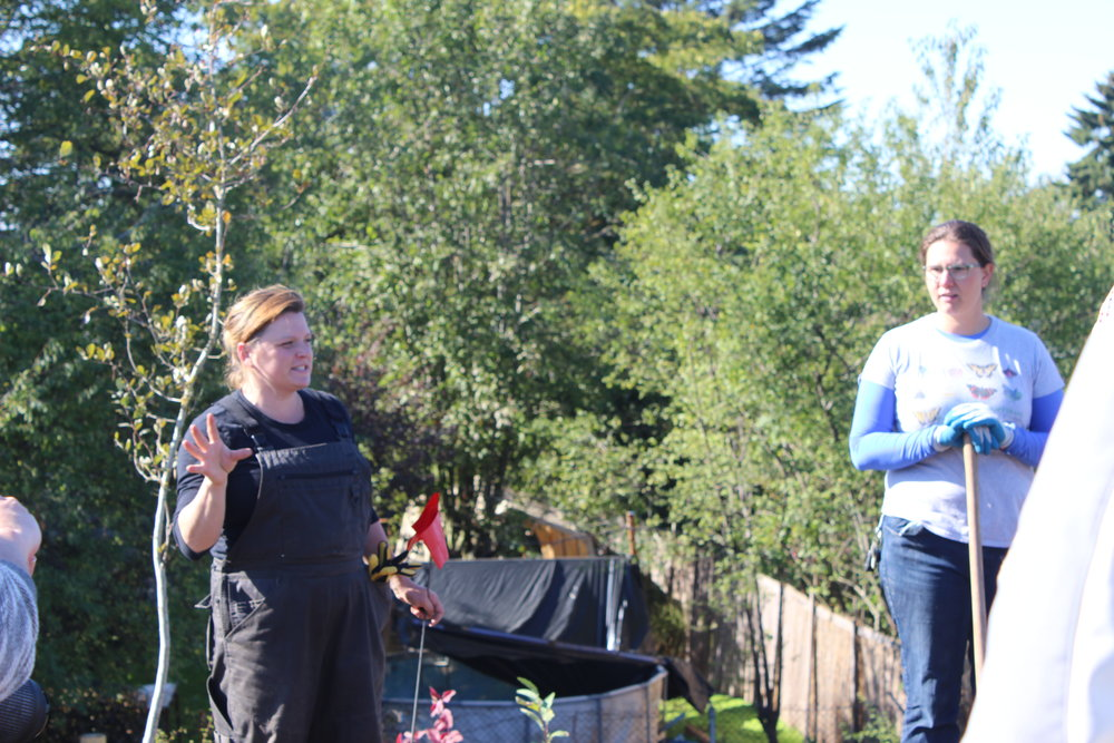 Shawna Zierdt and Isabel LaCourse from Portland Community Gardens teach volunteers how to plant at the Native Gathering Garden planting in October 2017.