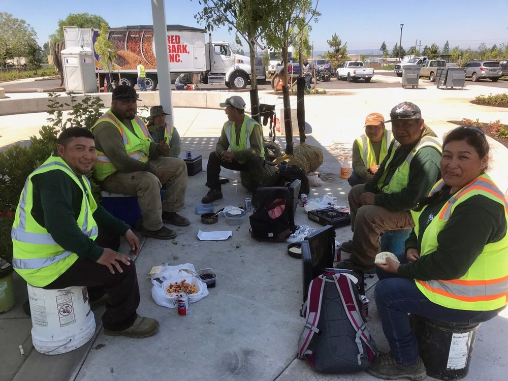 Verde Landscape Crew Members take a lunch break while working at Cully Park