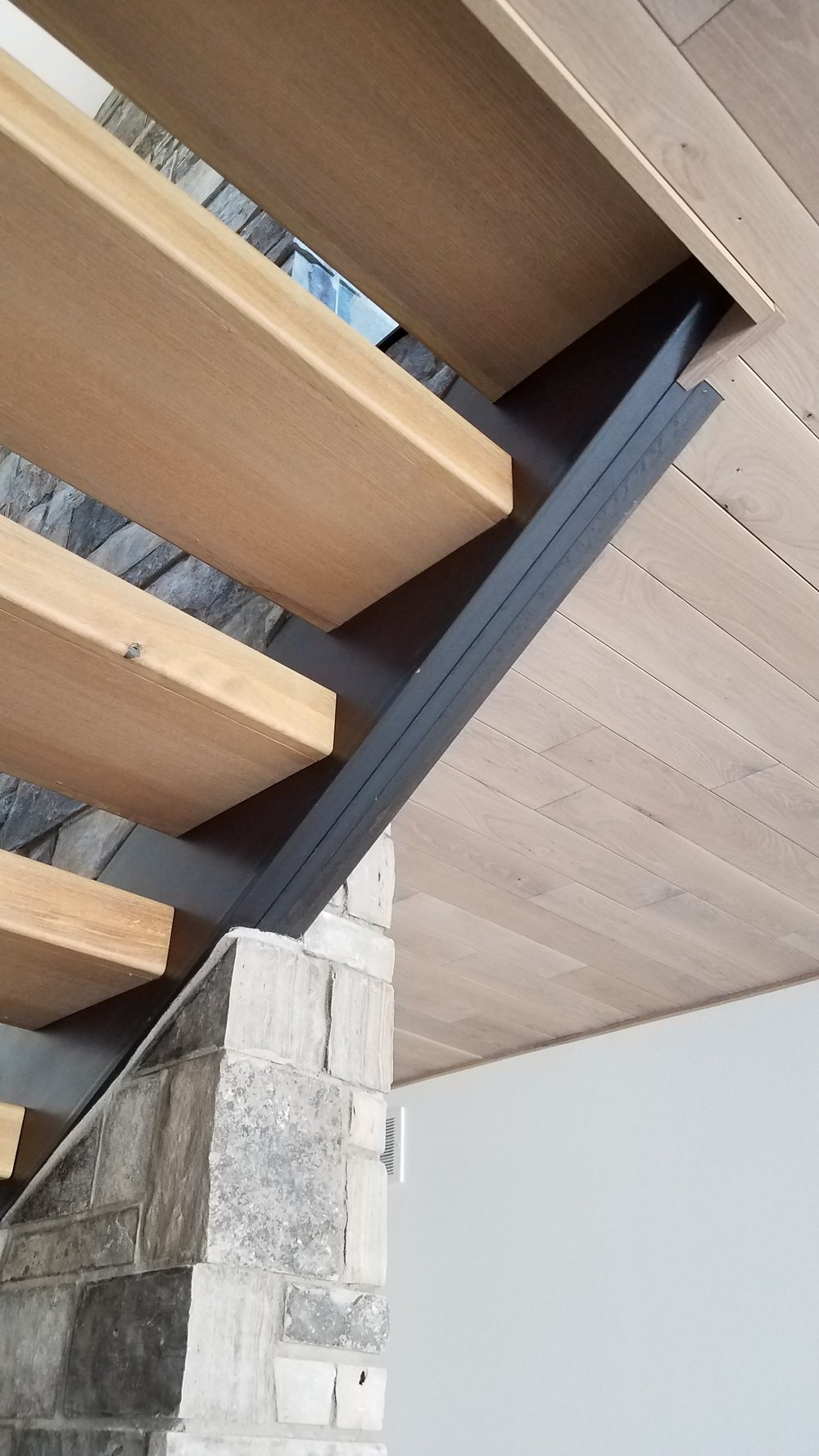 Steel Stringers to Accomplish a Floating Stair Look