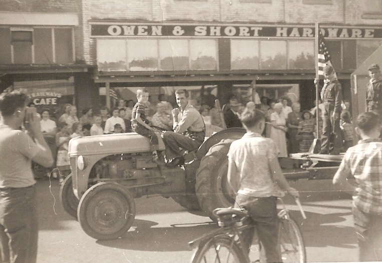That's me straddling the tractor as my dad pulls the Boy Scout float in the 1953 Republic Independence Day Parade. Eisenhower was president.