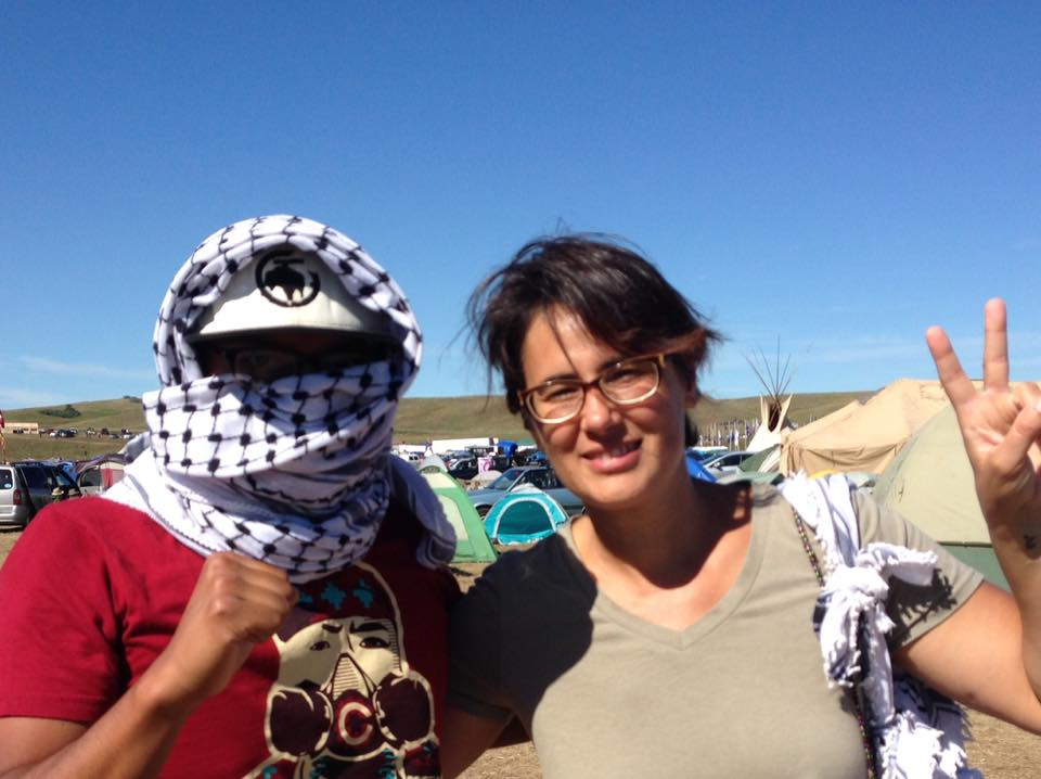 Salma Abu Ayyash and a water protector wearing the Palestinian scarf. (Photo credit: Friends of Salma)