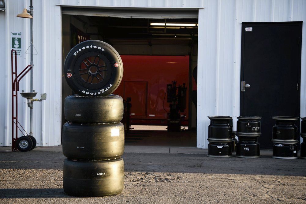 Evening light shines on a set of Firestone tires before evening practice at Phoenix