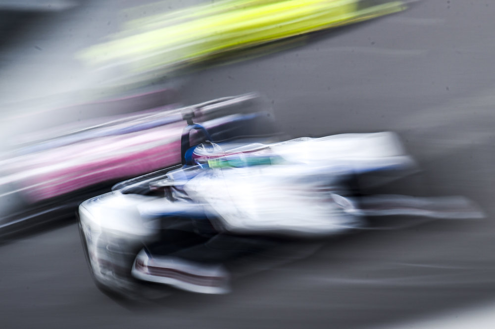 Graham Rahal blurs through turn 1 at IMS. We shoot so many photos in May. It's fun to play with settings.