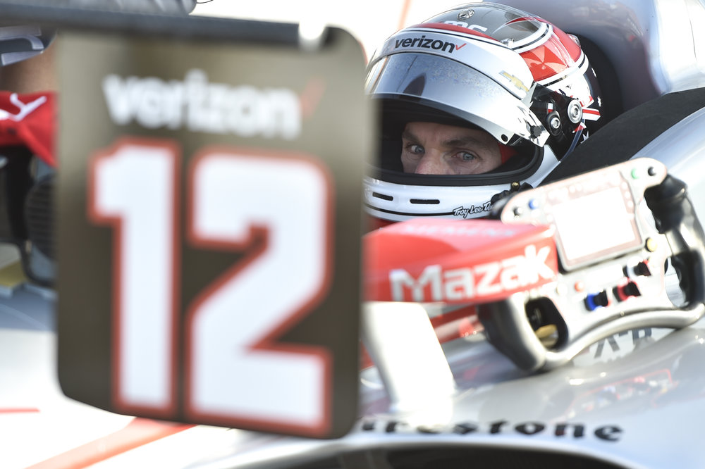 Will Power waits as his crew makes adjustments during practice.