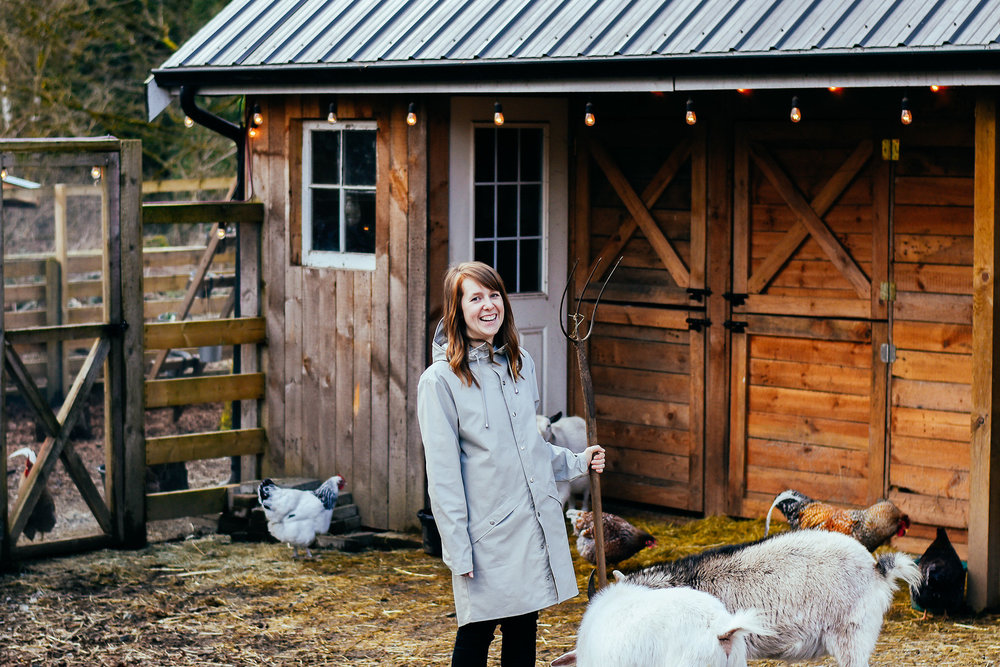 laughing with a pitchfork, because staged farm yard shots are funny when you pretend to be working with a pitchfork in an expensive rain coat