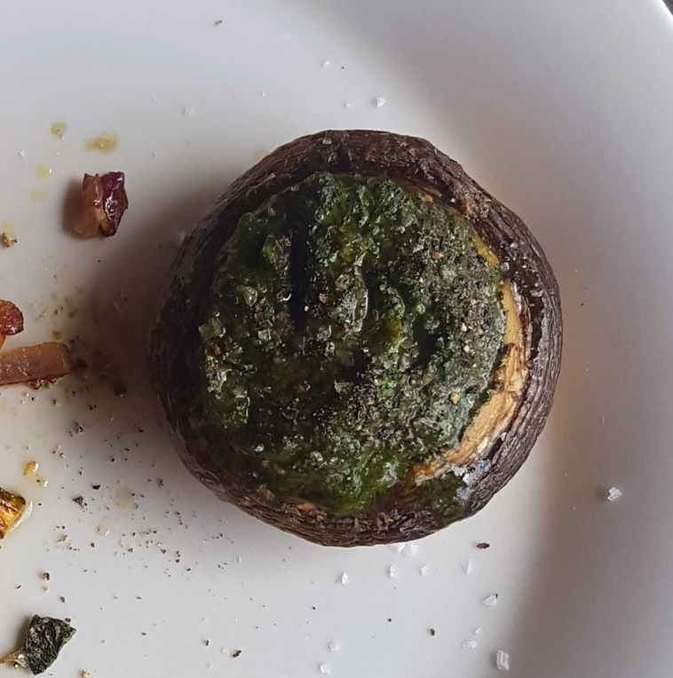 Cricket pesto stuffed roast mushroom.