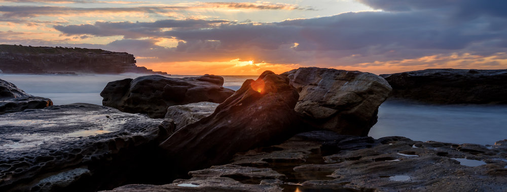 Photo Credit Gratitude to Ding Chen, Little Bay Local, depicting the rock pools at Little Bay and the spark of light we honour in ourselves.