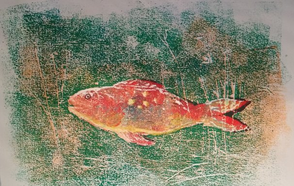Orange fish on green background embellished with yellow crayon and brown ink
