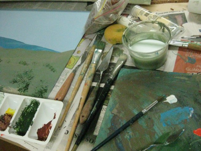 acrylic paints, a palette, brushes, lichen , water and mixing tray