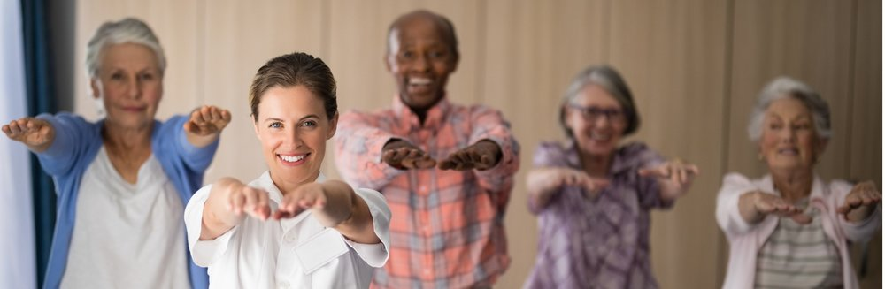 portrait-of-smiling-female-doctor-and-seniors-exercising-picture-id820253826.jpg