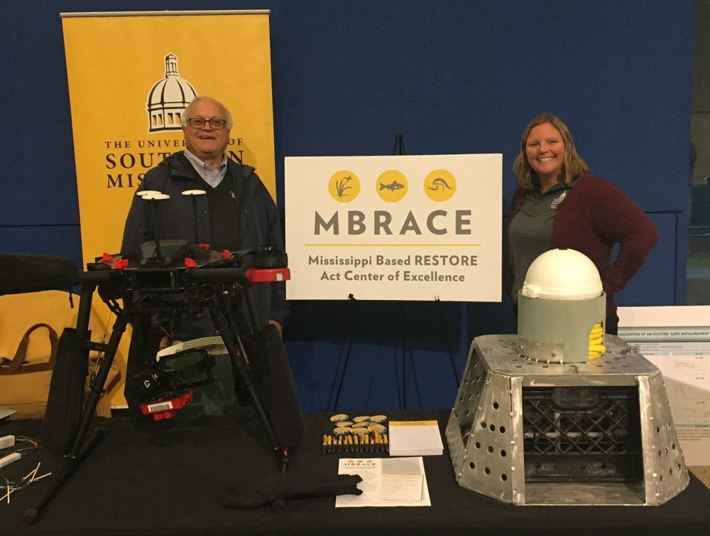 MBRACE administrators at the 2018 Restoration Summit. From left to right: Landry Bernard (MBRACE Chief Scientist) and Kelly Darnell (MBRACE Deputy Director).