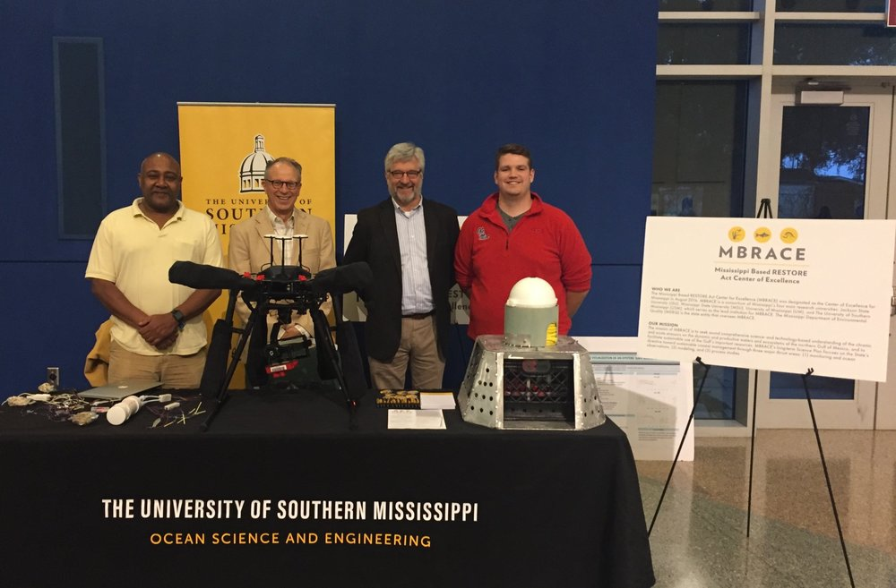 MBRACE-funded investigators displayed technology used in their projects. From left to right: Kamal Ali (JSU), Robert Moorhead (MSU), Greg Easson (UM), and graduate student Jarett Bell (UM).