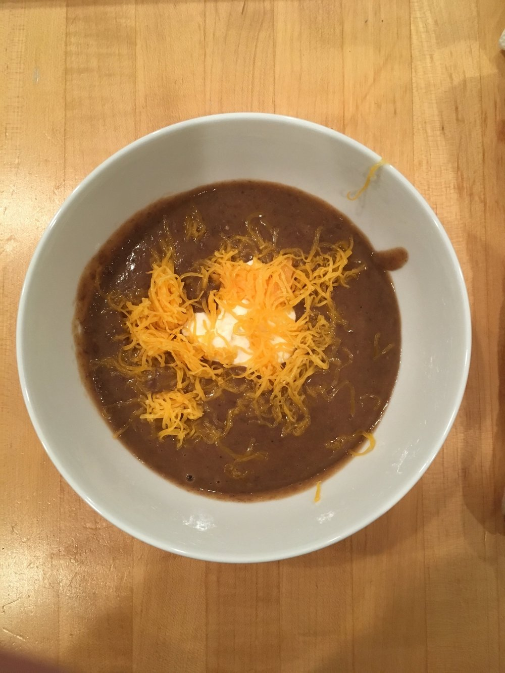 Black Bean Soup  Ingredients  -3 tablespoons olive oil -1 large onion, cut in half and thinly sliced -1½ teaspoons sea salt -3 large garlic cloves, sliced -12 sprigs fresh coriander, chopped -1 teaspoon ground cumin -¼-½ teaspoon chili powder -¼-½ teaspoon chipotle chili powder -4 cups black beans (soak overnight then drain first) -3 cups chicken stock  Directions  1. Heat the olive oil in a heavy-bottomed pot or casserole dish over medium-high heat. 2.Add the onion and salt and sauté for 5 minutes, stirring often and lowering the heat if the onion starts to brown too much. 3.Add the garlic, coriander and spices. 4.Cover and cook for 5 minutes more, checking every minute or so to make sure everything is gently sautéing and not burning. 5.Add the black beans and chicken stock, bring the mixture to a boil and simmer, uncovered, for 15 minutes. 6.Using an immersion blender, blend the soup directly in the pot until almost completely smooth. Adjust the seasoning to taste, and sprinkle with cheese.If you want, you can even add a dollop of SCD yogurt as a mock-sour cream. Enjoy!