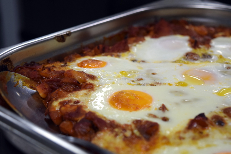 pulled pork and bean chilli with baked eggs