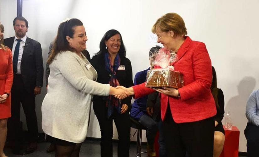 Salma Alarmachi, co-founder Jasmin Catering, meeting German Chancellor Angela Merkel Image courtesy: Jasmin Catering Facebook Page