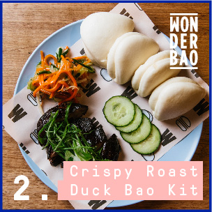 Roast duck leg with homemade XO Sauce and pickles
