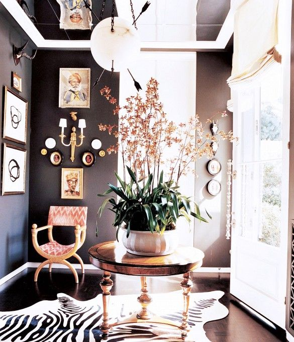 Dark walls - Mixing textures, patterns and eras to create a statement. Image via Pinterest.