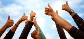 "group of people holding a ""thumbs-up"" in the clear sky"