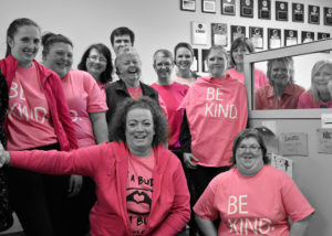 Director on call call answering agents wear their pink shirts to raise awareness on bullying for pink shirt 2018.