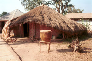 Tribal Hut with drum outside of entrance