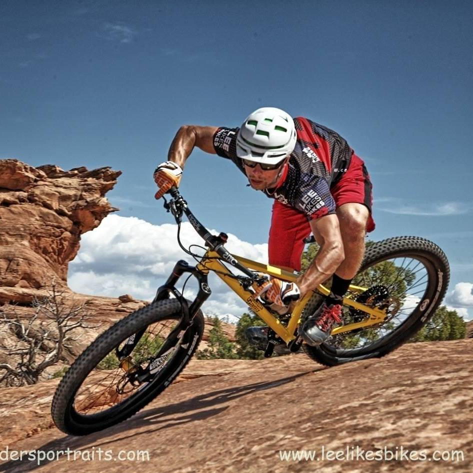 Showing clients in Moab, UT one way to Shred an off-camber, downhill sloping corner.