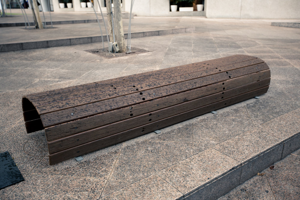 11. Kallang Bench   The design seeks to commemorate the demolished but ubiquitous influence of the former Stadium in everyone's hearts. The weathered planks with their old bolt holes are now designed for a new context.  Design:Studio Juju