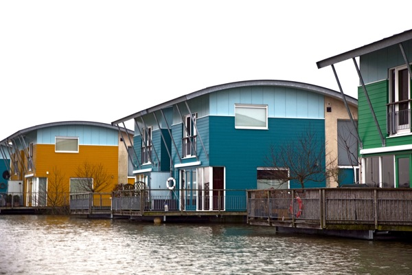 Floating homes on the Meuse River. Photo by  Peter Minemma .