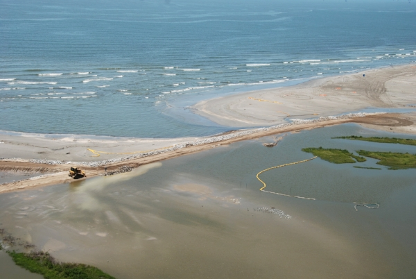 Louisiana National Guard reinforcing oil protection barriers, Elmer's Island, LA.  Photo by Sgt. Michael Owens via  Wikimedia Commons .