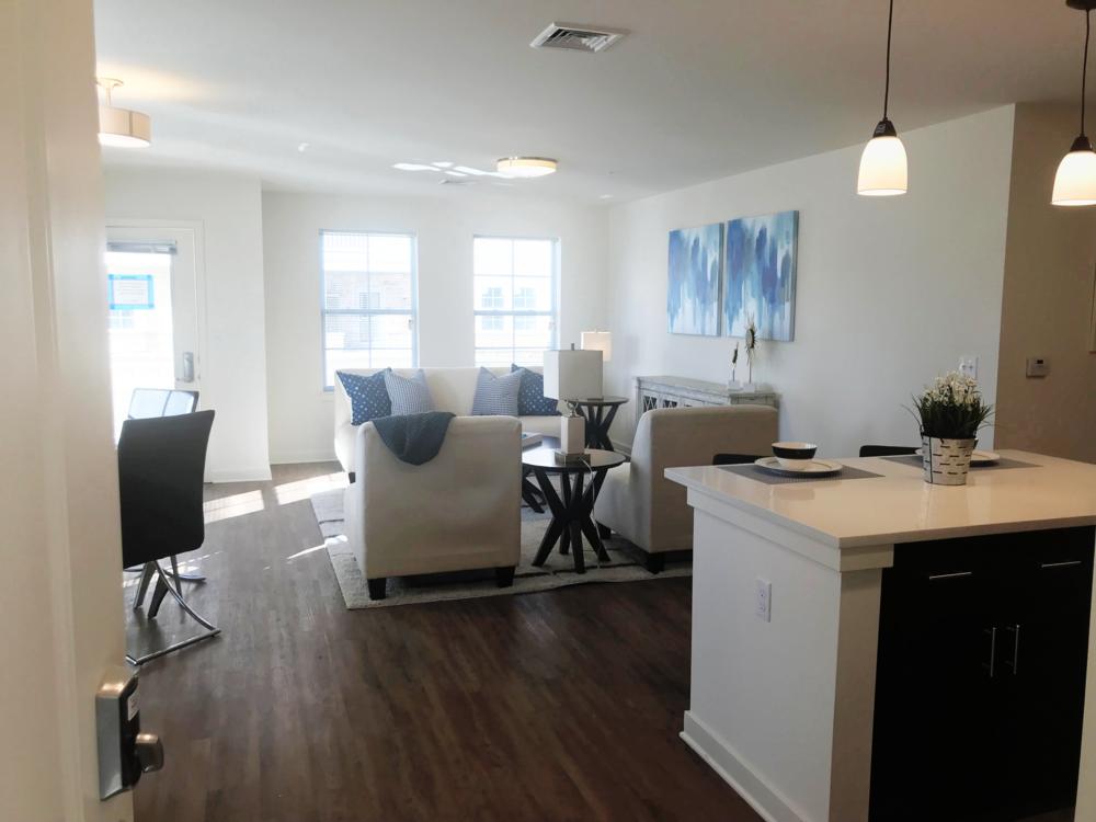 timbercreekapts_kitchen_livingroom_brandmint_05.29.2018.png