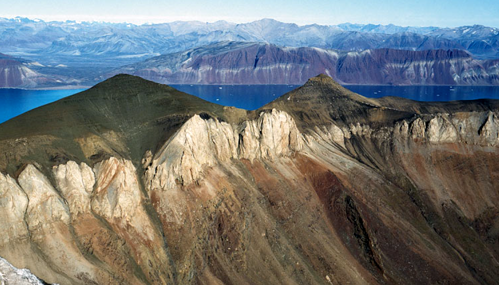 Exposure of the Wegener Halvø formation, looking towards Fleming Fjord.  Image sourced from public domain technical reports released by the Government of Greenland.