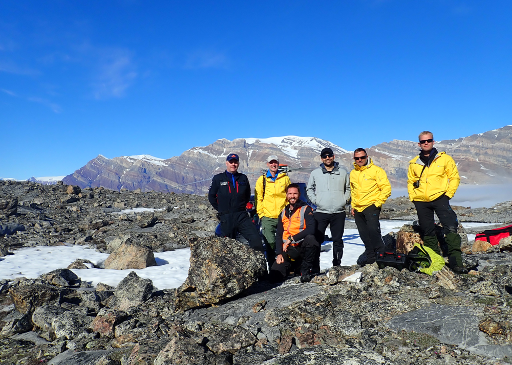 The 2018 Frontier Startup Crew with a stunning view across a fog filled fjord to Lyell Land (background).