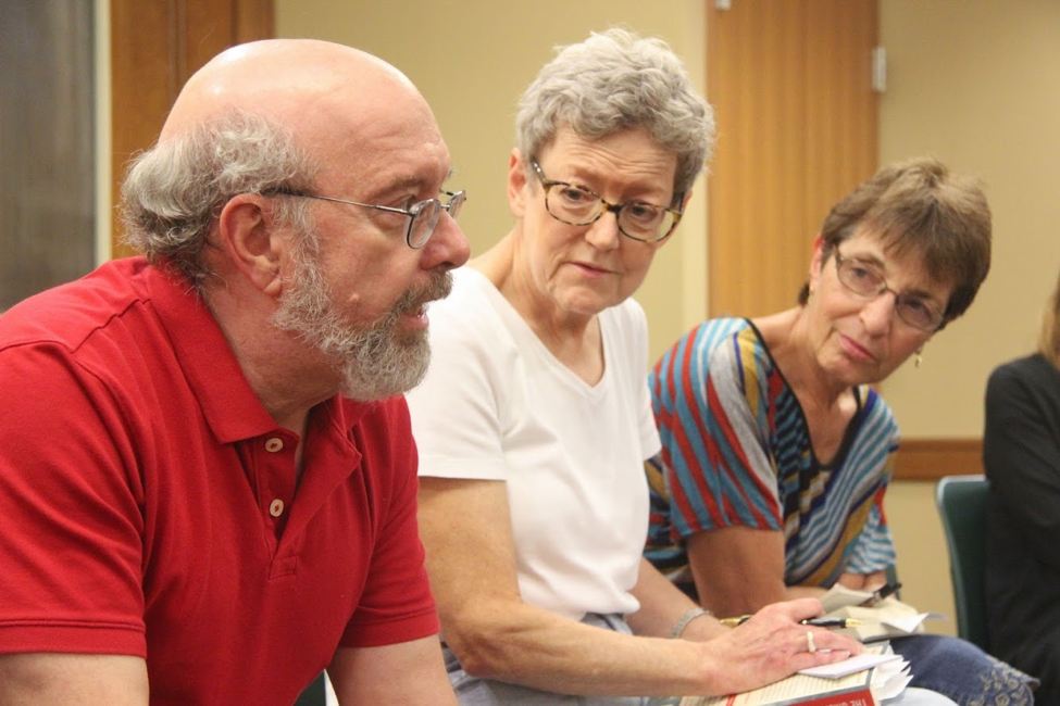 A photo of community members engaging in debate during a book discussion at the Leominster Public Library