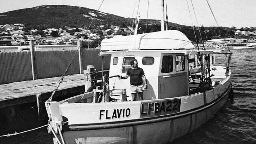 "Gordon Cruickshank on his fishing boat ""Flavio""   Courtesy: WA Museum"