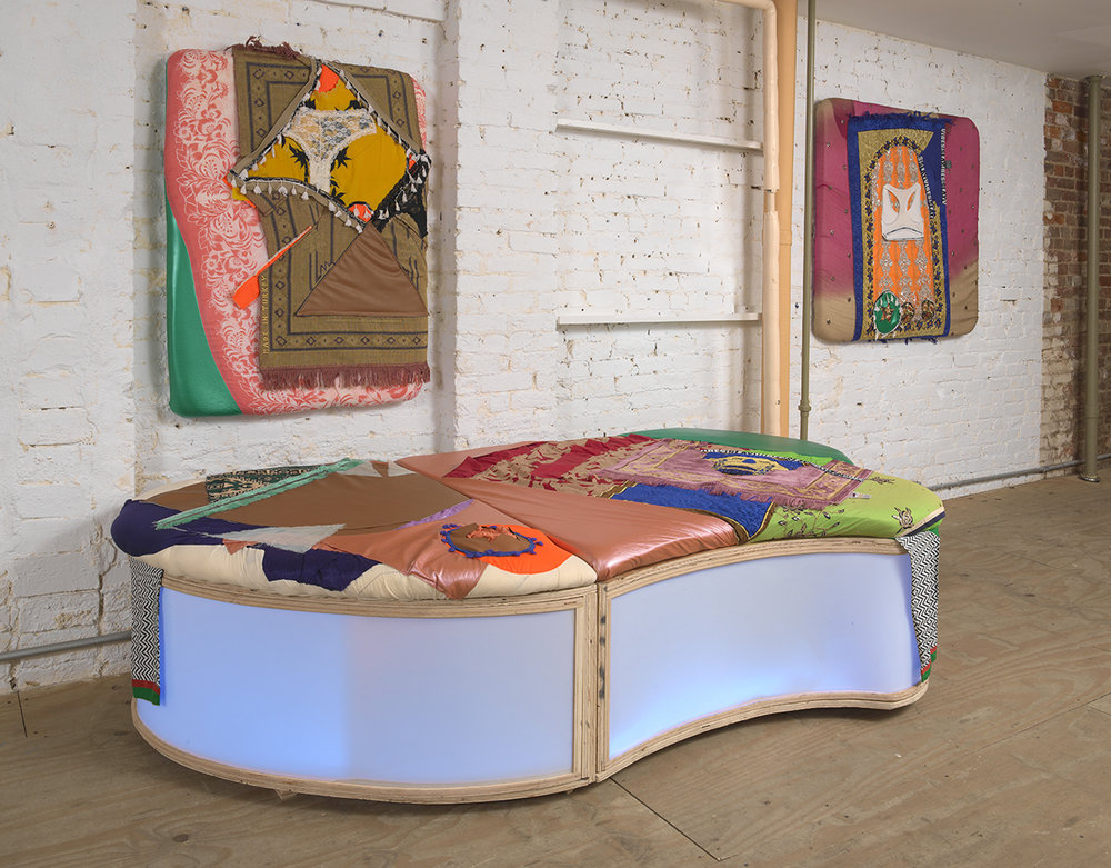 (Furniture)  Seats #6/8 [Feat.],  (Left to right on wall) #12 and #7  [Feat.] , Pleather, artist's underwear, prayer rugs, wood, plexi, speakers and sound, 22 x 120 x 52 in, 2018