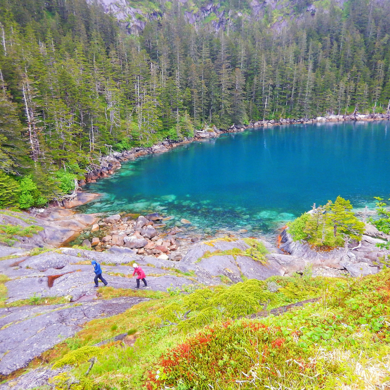 Passengers hike in an isolated fjord on Seward Alaska Boat Tours with Alaska Fjord Charters