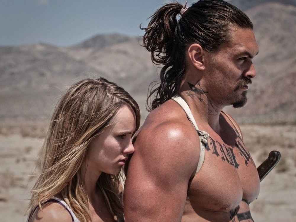 Jason Momoa In The Bad Batch Will Fill The Khal Drogo-Shaped Hole In Your Heart - Last week, we mourned the six-year anniversary of the day we lost one of the greatest TV characters of all time, Khal Drogo. (Shame on you if you missed it.) The Khal was a complicated man — terrifying, sexy, mildly insane, surprisingly deep, violent, poetic — but ultimately a great one. He was played to literal perfection by strapping actor Jason Momoa, who put his heart and soul into Drogo's grunts and snarls.(Please, try to imagine literally anyone else in that role.) All that was ripped away from us in an instant when George R.R. Martin (and whatever heartless bastards are running things at HBO) decided it would be a good idea to kill off a goddamn Game of Thrones icon.But dry your tears: the second coming of Khal Drogo is here. Jason Momoa plays a reincarnation of the Dothraki king in his new film The Bad Batch, a cannibal thriller/black rom-com from Ana Lily Amanpour and a loopy, beautiful trip. It's set in a dystopian future — a surreal world of sun-scorched savagery, where mainstream society's convicts and rejects (the
