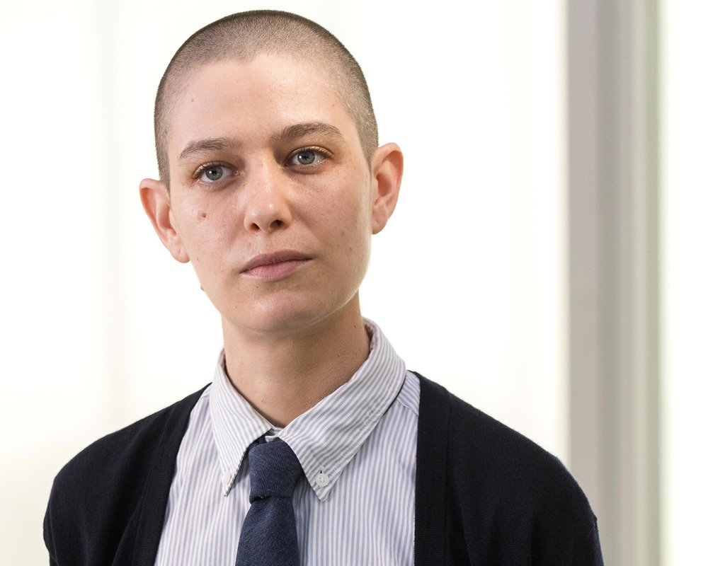 "ASIA KATE DILLON  - A couple of years ago, Asia Kate Dillon started removing the feminine pronouns from their online press material, replacing ""she,"" ""her,"" and ""hers"" with simply their name. ""That felt really good,"" Dillon recalls. But it wasn't until a couple of years later, when Dillon was prepping to audition for Showtime drama Billions season 2, that they found the language to explain why that move felt so damn right.The role Dillon read for (and ultimately got) is that of Taylor, an exceptionally brilliant intern at Axe Capital, the hedge fund firm run by Bobby Axelrod (Damian Lewis). What sets Taylor apart from their fellow financial analysts at first glance is the fact that they identify as gender non-binary, meaning they experience and express their gender identity outside of our heteronormative denominations of man or woman — a simplistic rigidity only underscored by Axe Capital's hyper-masculine office culture. And when Dillon first read Taylor's character description, they had the uncanny sensation that they were reading about themselves.""I did some research into non-binary, and I just thought 'Oh my gosh,' like, 'that's me...that's who I am,'"" Dillon tells me over the phone, a few days before the Billions season 2 premiere. ""It's interesting how labels can really box us in, but they can also be very freeing,"