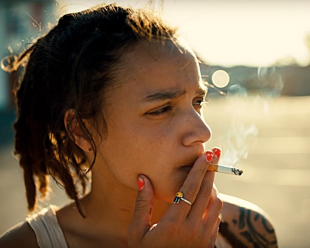 SASHA LANE - Most young actresses work for years trying to break into Hollywood by way of L.A. casting couches. Sasha Lane was dancing with the sand between her toes, on spring break in Panama Beach, when her big break arrived. In a sea of Solo cups and string bikinis, director Andrea Arnold saw Lane — her expressive doe eyes, her easy verve — and found the star she didn't quite know she was looking for. One year later, Lane was dancing again — this time, on the red carpet at Cannes.It's exactly that kind of organic spontaneity — being open to meeting a perfect stranger on a beach — that made Lane the perfect person to lead American Honey, a sprawling, 162-minute cinéma vérité-inspired masterpiece in the guise of a road-trip movie. The film isn't really a coming-of-age tale either, but it has the bittersweet tinge of one. Except its subjects aren't the rich, white suburban kids whose stories we've heard time and time again. They're a motley crew of transient teens and 20-somethings who travel by van selling magazine subscriptions door-to-door by day and party hard by night, and Lane's character, Star, latches on to them. Ambling through the flyover states, we get gritty closeups of the parts of America that Hollywood glosses over — motel rooms, Kmart parking lots, oil fields and truck stops. But we also see scenes of overwhelming beauty that celebrate life. Call it 2016 Americana...READ ON R29