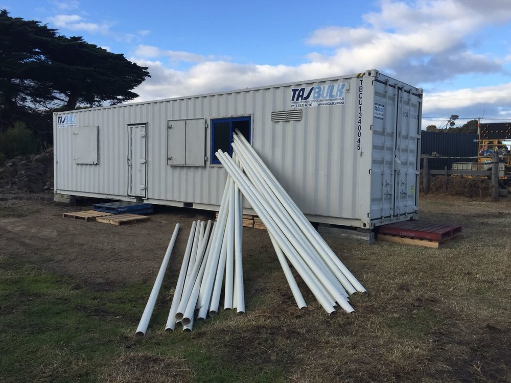 Container placed onto Hatchery site - unloding PVC piping